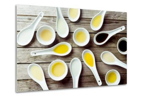 Several Soup Spoons and Sauce Dishes Arranged Randomly on Wooden Surface-stockcreations-Metal Print