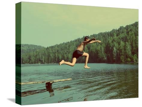Boy Jumping in Lake at Summer Vacations - Vintage Retro Style-Kokhanchikov-Stretched Canvas Print