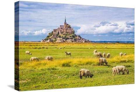 Beautiful View of Famous Historic Le Mont Saint-Michel Tidal Island with Sheep Grazing on Fields Of-canadastock-Stretched Canvas Print