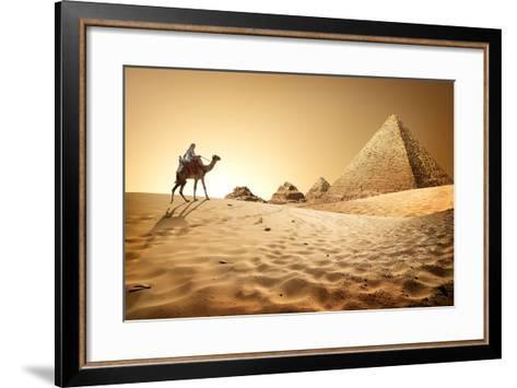 Bedouin on Camel near Pyramids in Desert- Givaga-Framed Art Print