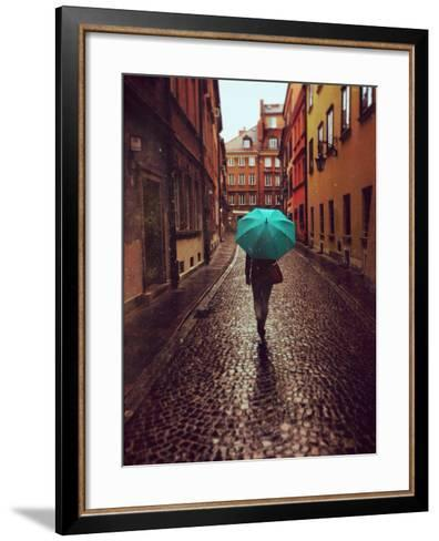 Woman with Umbrella Walking on the Rain in Old Town of Warsaw, Poland. Vintage Edited Picture-Happy Moments-Framed Art Print