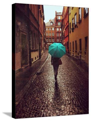 Woman with Umbrella Walking on the Rain in Old Town of Warsaw, Poland. Vintage Edited Picture-Happy Moments-Stretched Canvas Print