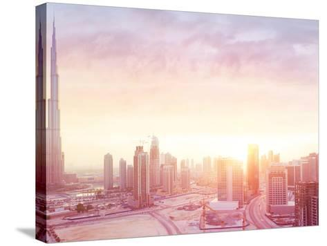 Beautiful Sunset over Dubai City, Amazing Cityscape Lit with Warm Sun Light, Contemporary New Moder-Anna Om-Stretched Canvas Print
