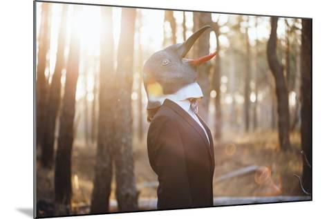 Weird Businessman Wearing a Bird Rubber Mask in the Autumn Sunset Forest- AnastasiaNess-Mounted Photographic Print