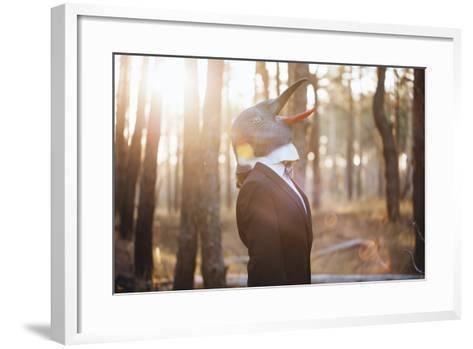 Weird Businessman Wearing a Bird Rubber Mask in the Autumn Sunset Forest- AnastasiaNess-Framed Art Print