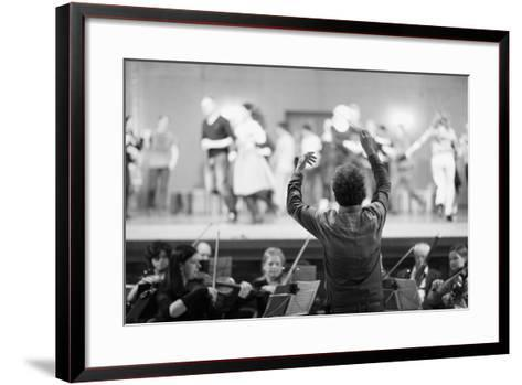 Orchestra Conductor Leading the Musicians in the Theater-Anna Jurkovska-Framed Art Print