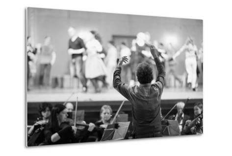 Orchestra Conductor Leading the Musicians in the Theater-Anna Jurkovska-Metal Print