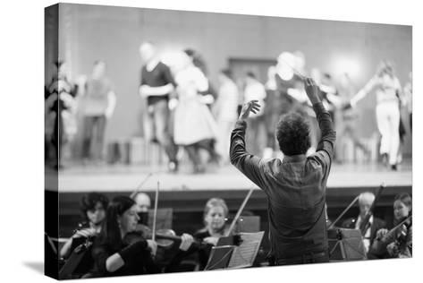 Orchestra Conductor Leading the Musicians in the Theater-Anna Jurkovska-Stretched Canvas Print