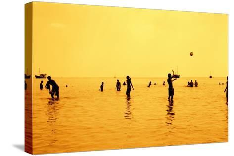 Silhouettes of People Playing Games in the Sea Full of Sailing-Ship-Dimitar Yalamov-Stretched Canvas Print