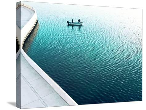 Two Men Fishing on a Lake in a Very Contemporary Urban Setting.-Todd Klassy-Stretched Canvas Print