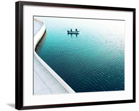 Two Men Fishing on a Lake in a Very Contemporary Urban Setting.-Todd Klassy-Framed Art Print