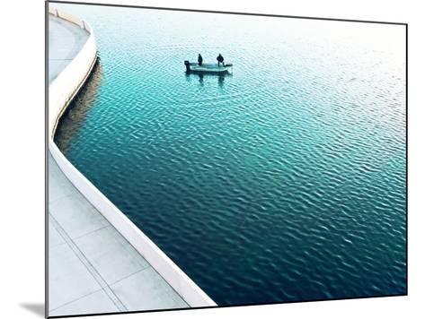 Two Men Fishing on a Lake in a Very Contemporary Urban Setting.-Todd Klassy-Mounted Photographic Print