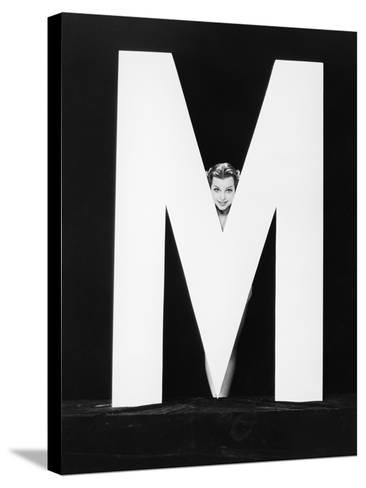 Womans Face with Huge Letter M-Everett Collection-Stretched Canvas Print