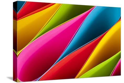 Colorful Card Stock in Unique Elliptical Shapes with Shadow Effect and Selective Focus on a Black B-Fotoluminate LLC-Stretched Canvas Print