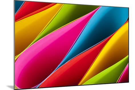 Colorful Card Stock in Unique Elliptical Shapes with Shadow Effect and Selective Focus on a Black B-Fotoluminate LLC-Mounted Photographic Print