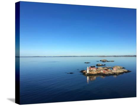 Seascape of a Swedish Fjord with Little Lighthouse on a Rocky Island- adiekoetter-Stretched Canvas Print