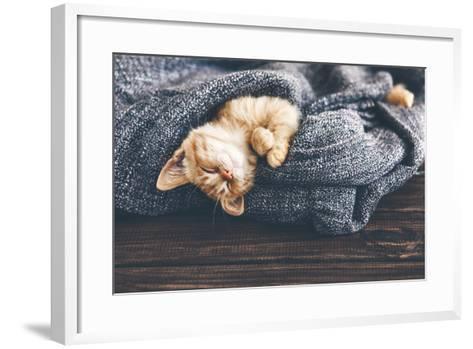 Cute Little Ginger Kitten is Sleeping in Soft Blanket on Wooden Floor-Alena Ozerova-Framed Art Print