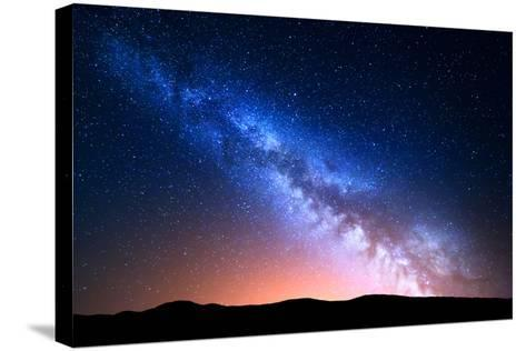 Night Landscape with Colorful Milky Way and Yellow Light at Mountains. Starry Sky with Hills at Sum-Denis Belitsky-Stretched Canvas Print