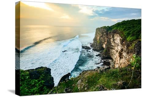 Scenic Coastal Landscape of High Cliff at Sunset near Uluwatu Temple, Bali Island, Indonesia- Zephyr_p-Stretched Canvas Print