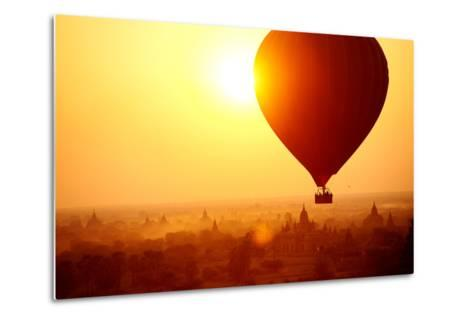 Silhouette of Hot Air Balloon over Bagan in Myanmar, Tourists Watching Sunrise over Ancient City-Daxiao Productions-Metal Print