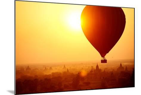 Silhouette of Hot Air Balloon over Bagan in Myanmar, Tourists Watching Sunrise over Ancient City-Daxiao Productions-Mounted Photographic Print