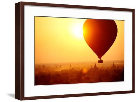 Silhouette of Hot Air Balloon over Bagan in Myanmar, Tourists Watching Sunrise over Ancient City-Daxiao Productions-Framed Art Print
