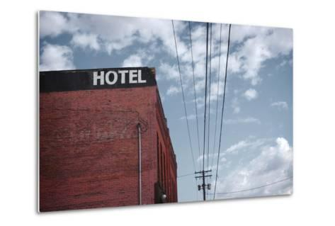 Old Dilapidated Brick Motel with Cloudy Sky- J D S-Metal Print