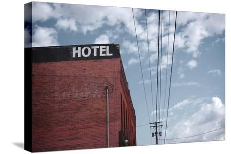 Old Dilapidated Brick Motel with Cloudy Sky- J D S-Stretched Canvas Print