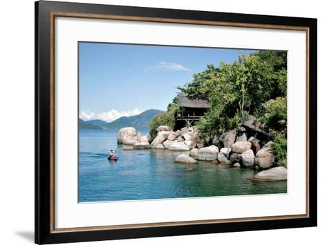 A Paddler Explores the Scenic Rock Formations of the Islands of Lake Malawi, Malawi, Africa, in His- SAPhotog-Framed Art Print