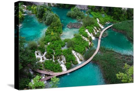 Waterfalls in Plitvice National Park. Aerial View. One Vivid Turquoise Lake Flows into Another.-Evgeniya Moroz-Stretched Canvas Print