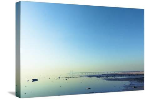The Bridge between Denmark and Sweden, Oresundsbron, in Early Morning Light in April.- kimson-Stretched Canvas Print
