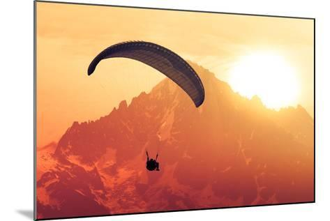 Sepia Paraglide Silhouette over Alps Peaks-Pavel Burchenko-Mounted Photographic Print
