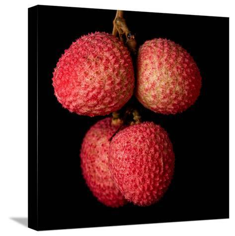 A Bunch of Lychees against a Black Background- hein-Stretched Canvas Print