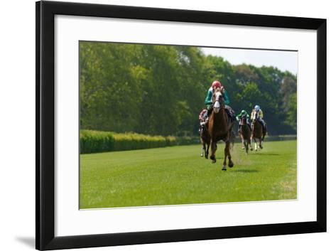 Several Racehorses with Jockeys during a Horse Race- gibleho-Framed Art Print