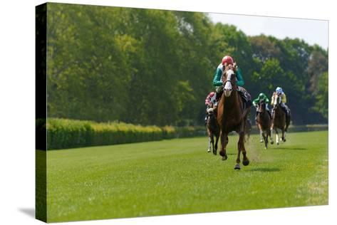 Several Racehorses with Jockeys during a Horse Race- gibleho-Stretched Canvas Print