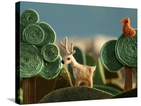 Woods Closeup with Deer and Bird on the Tree - Stylized Alpine Landscape Made of Wool- KREUS-Stretched Canvas Print