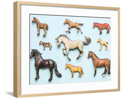 Flat Lay View of Neatly Arranged Plastic Horse Toys- pirke-Framed Art Print