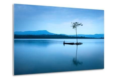 Natural Landscape in Blue. A Boat Floating in Smooth Water at Tranquil Lake .Many Traveller Come Fo- worradirek-Metal Print