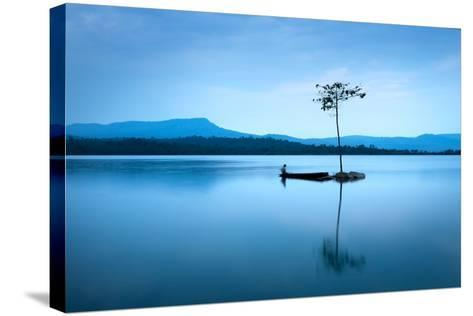 Natural Landscape in Blue. A Boat Floating in Smooth Water at Tranquil Lake .Many Traveller Come Fo- worradirek-Stretched Canvas Print
