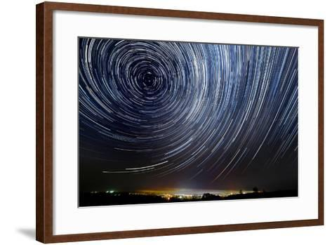 The Motion of Stars around Pole Star in the Night City- AlexussK-Framed Art Print