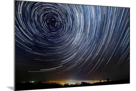 The Motion of Stars around Pole Star in the Night City- AlexussK-Mounted Photographic Print