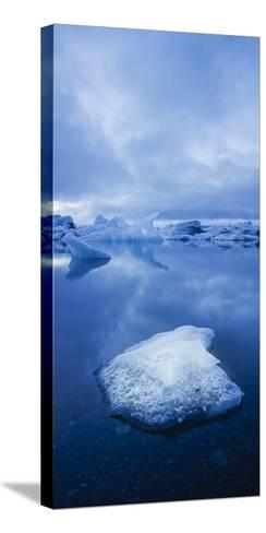 Icebergs 1 Vertical-Moises Levy-Stretched Canvas Print