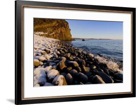 Rocky beach in winter with covering of snow-Charles Bowman-Framed Art Print