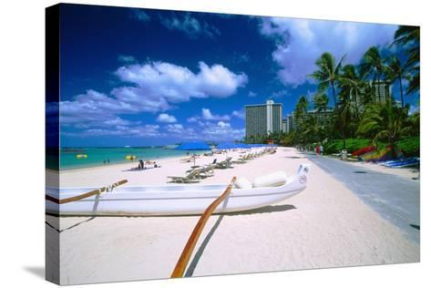 Beach Umbrellas and Outrigger Canoe-George Oze-Stretched Canvas Print