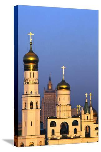Church towers and crosses of the Kremlin, Moscow-Charles Bowman-Stretched Canvas Print