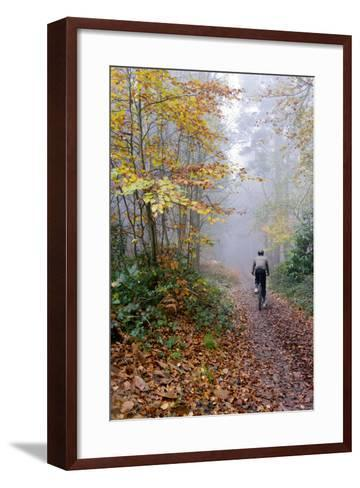 Forest cycling-Charles Bowman-Framed Art Print