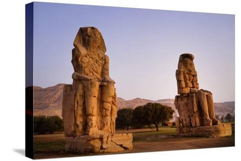Colossi Of Memnon In Egypt-Charles Bowman-Stretched Canvas Print