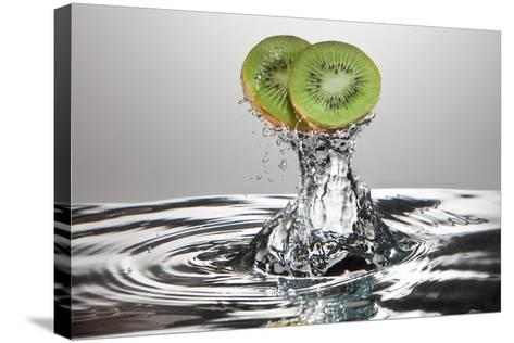 Kiwi FreshSplash-Steve Gadomski-Stretched Canvas Print