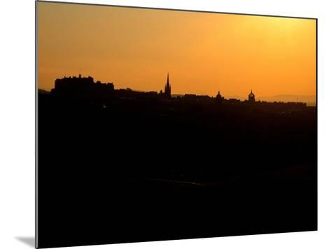 Edinburgh castle and city skyline at sunset, Scotland-AdventureArt-Mounted Photographic Print
