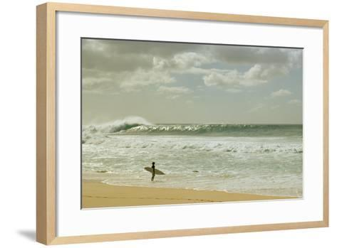 Surfer standing on the beach, North Shore, Oahu, Hawaii, USA--Framed Art Print